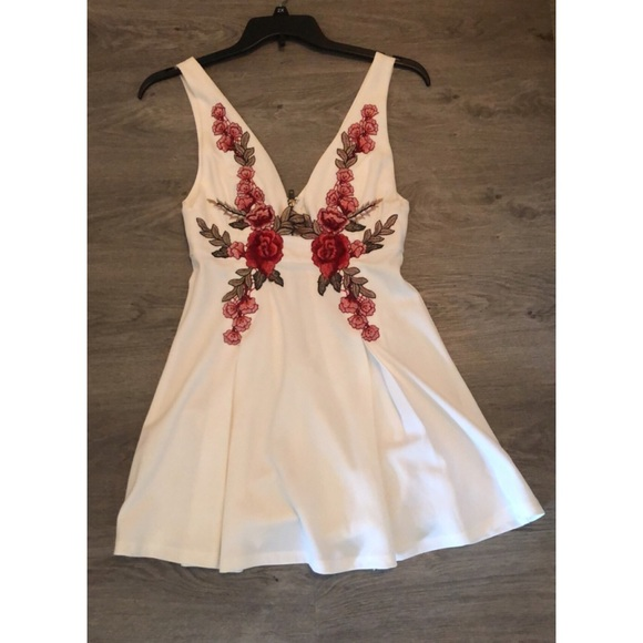 White skater dress with floral appliqué